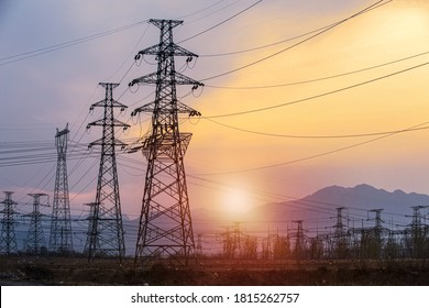 Silhouette high voltage electric pylon and electrical wire with an orange sky. Electricity poles at sunset. Power and energy concept. High voltage grid tower with wire cable at distribution station. - Shutterstock ID 1815262757