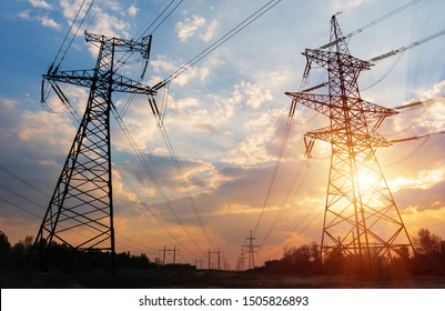 Silhouette High voltage electric tower on sunset time and sky on sunset time background