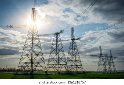 Silhouette High voltage electric towers. High-voltage power lines. Electricity distribution station