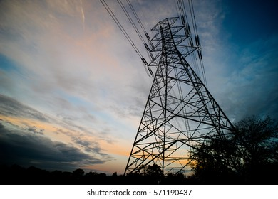 Silhouette of  High Voltage Electrical Pole Structure.