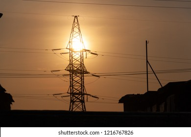 Silhouette of high voltage post. Norilsk. June 15, 2018