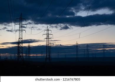 Silhouette of high voltage posts. Norilsk at sunset. September 27, 2018