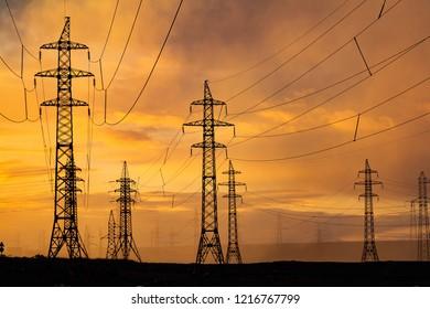 Silhouette of high voltage posts at sunset. Norilsk. September 19, 2018