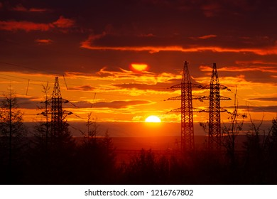 Silhouette of high voltage posts at sunset. Norilsk. September 08, 2018