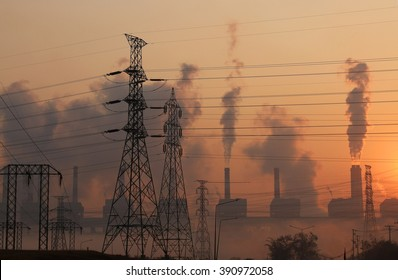 Silhouette high voltage transmission line and smoke from coal power plant background, Industry pollution