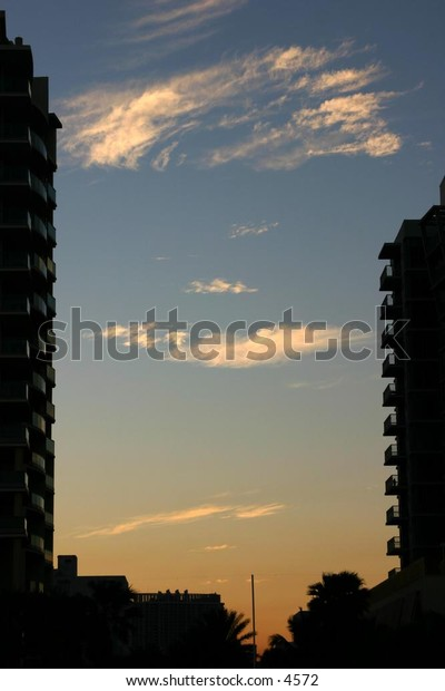 silhouette of highrise buildings at dusk
