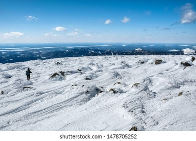 Silhouette of a hiker on summit of Katahdin mountain, Baxter state park, Maine, USA