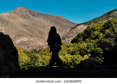 Silhouette of a hiker walking in the beautiful Imlil Valley in the foothills of the Atlas Mountains
