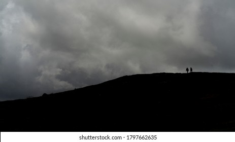 Silhouette of hikers on Brandon Point, Murirrigane, Brandon, County Kerry, Ireland