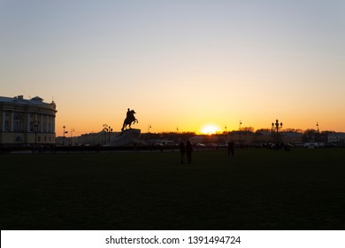 Silhouette of the historic monument to Peter the First (The Bronze Horseman) on the background of the sunset spring sky in St. Petersburg in Russia. Background, place for text.