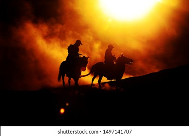 silhouette of horse rider at bromo