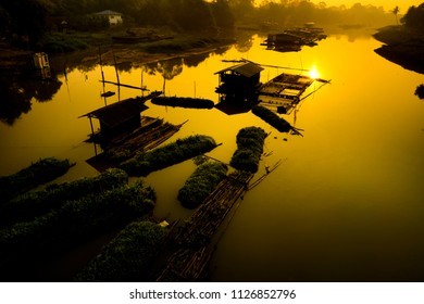 Silhouette House raft in the morning,at Sakae Krang River,Uthai Thani,thailand.