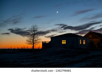 Silhouette of the house at sunset in the evening