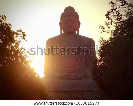 Silhouette of a huge statue of Buddha captured at sunset in Gaya city, India