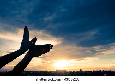 Silhouette human hands shape bird flying over sky and sunset background. Freedom concept.