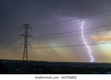 Silhouette of hydro tower with a backdrop of a thunder and lightning storm , two sources of power one man made the other nature