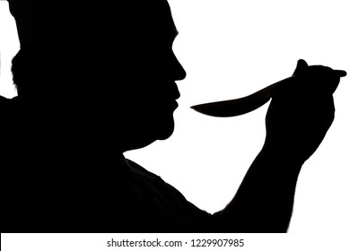 silhouette illustration of a chief-cooker head with spoon of soup, cooker tasting dish on a white isolated background, profile of a male face, food industry concept