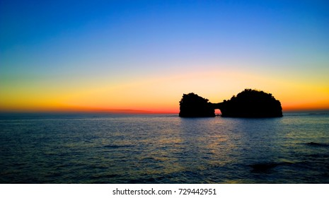 silhouette image of Engetsu Island under dusk sky in Shirahama, Wakayama, Japan