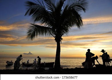 A Silhouette image of fishing village at sunset along west coast of  Martinique, Caribbean Sea