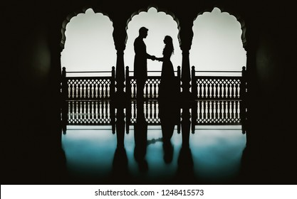 Silhouette Indian bride and groom holding hands Karachi, Pakistani, November 30, 2018