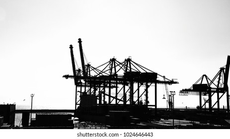 Silhouette industrial cranes at port harbour  over white background