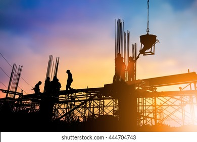 Silhouette industry engineer construction team to work safely on high ground heavy industry concept over blurred background sunset pastel.