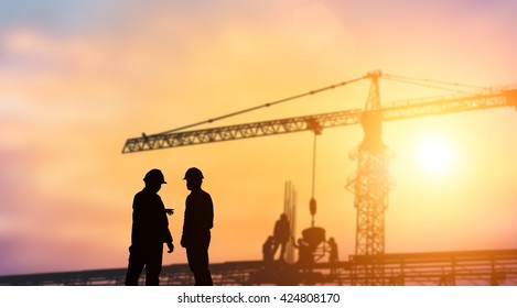 Silhouette industry engineer standing orders for construction team to work safely on high ground heavy industry concept. over blurred background sunset pastel