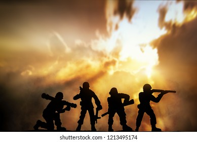 Silhouette of infantry on sky background. Veterans Day Concept