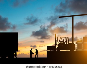 Silhouette inspector are examining the waybill with the Forklift and truck bringing up the goods in warehouses Business Logistics and Transportation over blurred natural background sunset pastel.