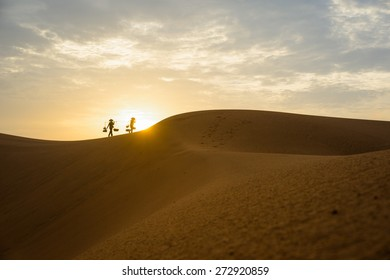 Silhouette of instant food vendors on red sand hill in Mui Ne, Binh Thuan, Vietnam