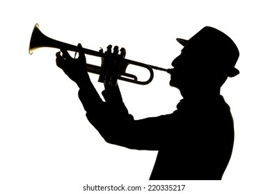 silhouette of a jazz man playing trumpet