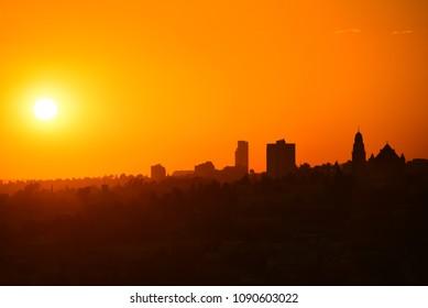 A silhouette of the Jerusalem skyline at sunset