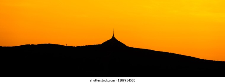 Silhouette of Jested mountain at sunset time, Liberec, Czech Republic. Panoramic shot.