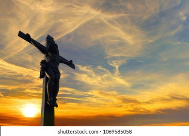 Silhouette of Jesus christ crucifix on cross over sunset and blue sky.Concept for Catholic religion, Christian worship, Christmas, Easter Day, Bible,Thanksgiving prayer and praise good Friday.