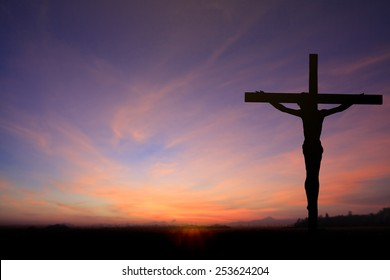 Silhouette Jesus Christ crucifixion on cross over calvary sunset background concept for he is risen in Jerusalem, easter day, good friday, Jesus loves you.