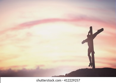 Silhouette Jesus Christ crucifixion on cross over calvary sunset background concept for he is risen in ascension, easter day, good friday jesus death on crucifix, Jesus loves you, prayer life