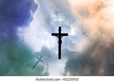 Silhouette Jesus and the cross falling from sky