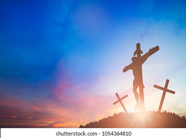 Silhouette of Jesus with Cross over sunset concept for religion, worship, Christmas, Good Friday,  Easter, Jesus he is risen, Thanksgiving prayer and praise, promise on prisoner