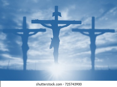 Silhouette of Jesus with Cross over sunset concept for religion, worship, Christmas, Easter, Redeemer Thanksgiving prayer and praise