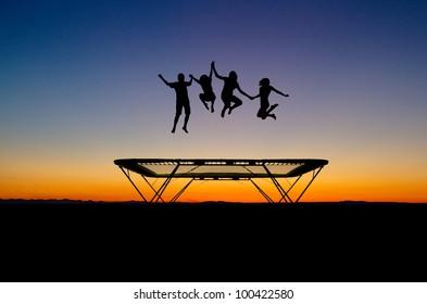 silhouette of kids on trampoline