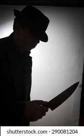 Silhouette of a killer with a knife in his hand
