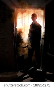 Silhouette of killer, standing with knife in his hand against smoke