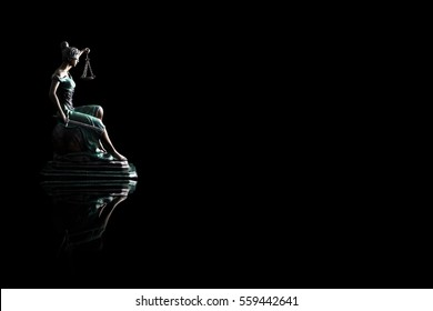 Silhouette Lady justice or Themis with reflection isolated on black background and space for text