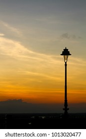 Silhouette of a lamp post against the sunset. Hoi an, Vietnam