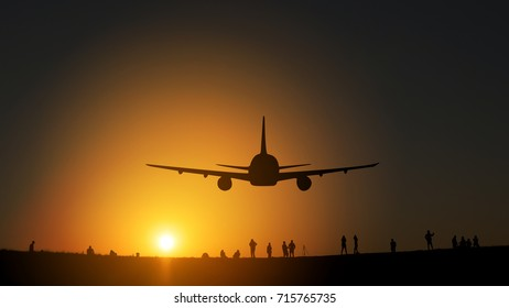 Silhouette from a landing plane that is flying to the airport. Photo taken during a nice colorful sunset.