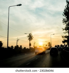 silhouette landscape of cars on road,sunset scene in Thailand