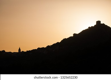Silhouette of Lastovo town with an old castle on top of the hill and church tower. Lastovo is one of the most remote islands in Croatia.