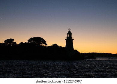 silhouette of lighthouse at sunset hell's gates macquarie harbour Tasmania