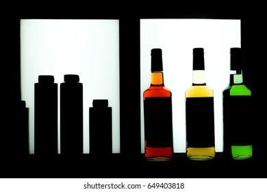 Silhouette of the liquor bottles in a cabinet.