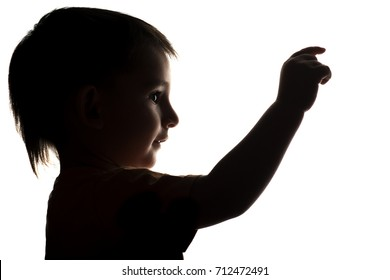 silhouette little boy touch screen, kid pushing on button by finger on a white isolated background